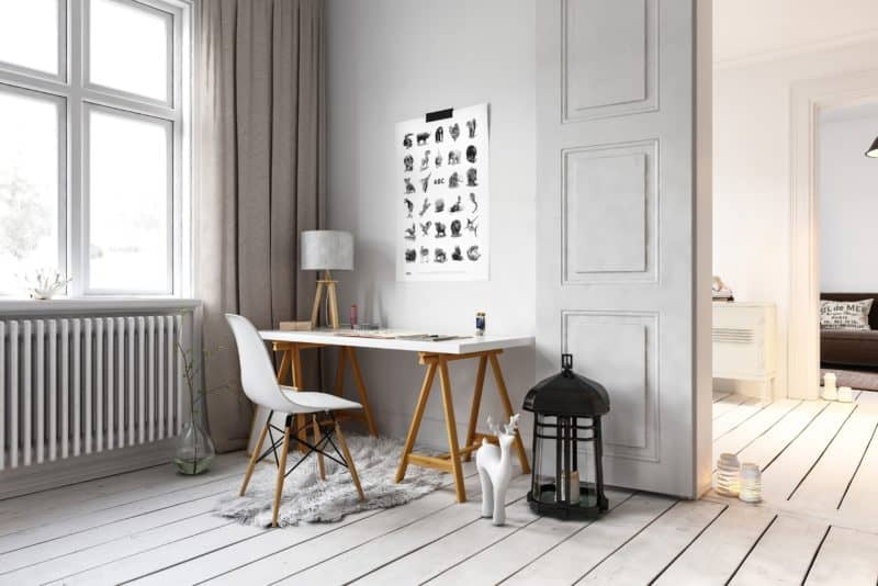 little desk and chair in loft with large lamp